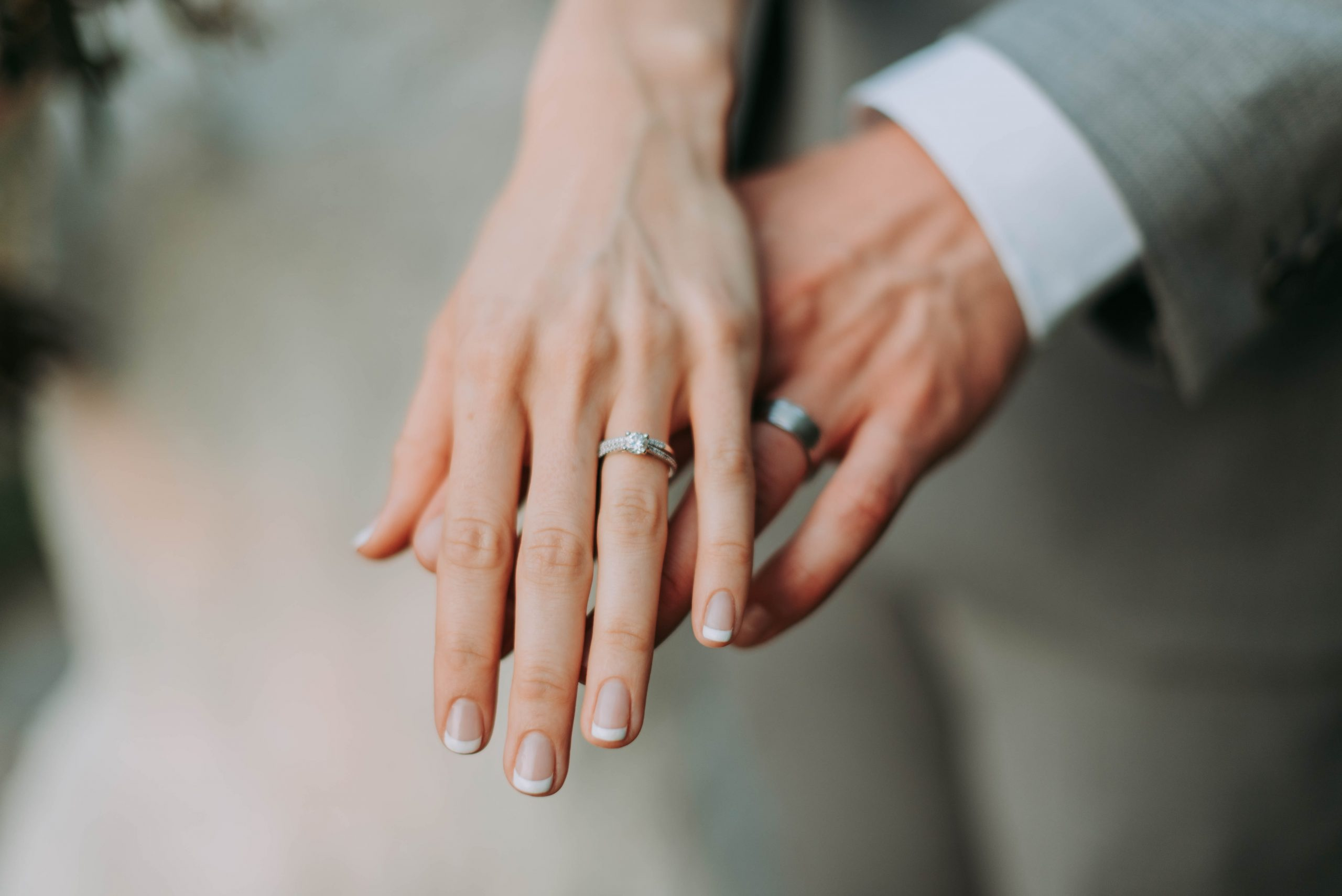 Married couple showing rings